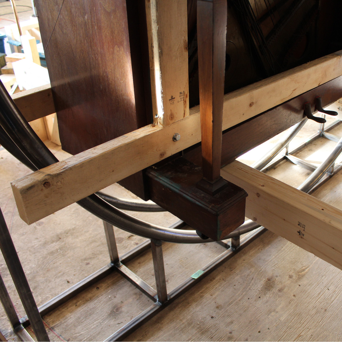 2x6s holding the piano up while working on the steel framework